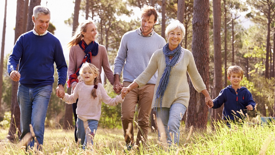 An intergenerational family enjoying the outdoors.
